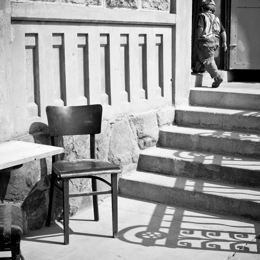 Boy and chair, Prague, Czech republic © lucia eggenhoffer